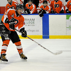WHITBY, ON - Feb 11: Ontario Junior Hockey League game between Orangeville Flyers and Whitby Fury. Ryan Anton #11 of the Orangeville Flyers Hockey Club passes the puck during first period game action.<br /> (Photo by Shawn Muir / OJHL Images)