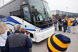 The West Virginia team bus enters the stadium in Memphis, TN for the Liberty Bowl.
