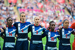 COVENTRY, ENGLAND - Friday, August 3, 2012: Great Britain's Anita Asante, Jill Scott, Stephanie Houghton, Eniola Aluko and Alex Scott line-up for the national anthem before the Women's Football Quarter-Final match between Great Britain and Canada, on Day 7 of the London 2012 Olympic Games at the Rioch Arena. Canada won 2-0. (Photo by David Rawcliffe/Propaganda)