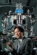 "One of the leading researchers at Japan's Waseda University's long-term robotics project, mechanical engineer Atsuo Takanishi studied under the late Ichiro Kato, a robotics pioneer, and superb fundraiser, who made the school into the epicenter of the field. Continuing Kato's emphasis on ""biomechatronics"", replicating the functions of animals with machines, Takanishi now supervises the research group that produced WABIAN-RII (behind him in photograph). Japan. From the book Robo sapiens: Evolution of a New Species, page 39."
