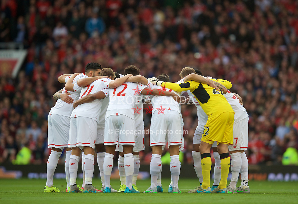 MANCHESTER, ENGLAND - Saturday, September 12, 2015: Liverpool players form a group huddle before the Premier League match against Manchester United at Old Trafford. (Pic by David Rawcliffe/Propaganda)