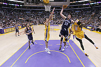 28 December 2005: Guard Mike Miller of the Memphis Grizzlies shoots the ball while scratching the face of Los Angeles Lakers guard Kobe Bryant during the 3rd period of the Grizzlies 100-99 victory over the Lakers at the STAPLES Center in Los Angeles, CA.