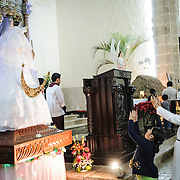 A nun and a girl take photos of some of the Christmas displays in the Cathedral of San Gervasio (Catedral De San Gervasio) in Valladolid in the heart of Mexico's Yucatan Peninsula.