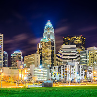 Downtown Charlotte North Carolina city at night photo with Romare Bearden Park. Charlotte is a major city in the Eastern United States.
