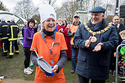 UNITED KINGDOM, Winchester: 05 March 2019 Winchester Pancake Race Photo Feature:<br /> A team member from 'Nightshelter' accepts the trophy for 'Best Attire' team to compete in the Inaugural Winchester Pancake Race earlier this afternoon on Shrove Tuesday. The race, which consisted of 20 teams, took place in the gardens surrounding Winchester Cathedral. <br /> Rick Findler / Story Picture Agency