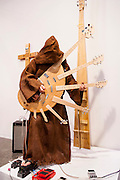 Artist in hooded monk's robe plays an amazing electric guitar with seven necks at Art Basel Miami Beach 2007