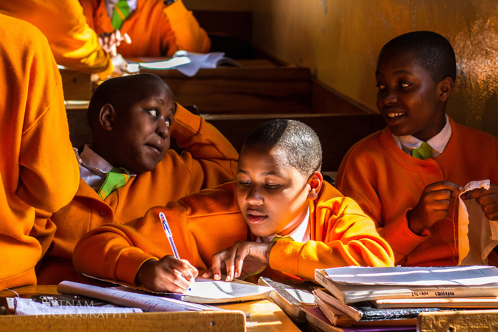Students interacting in class at Mazinde Juu Secondary School for Girls in the Usambara Mountains in Tanzania, Africa.
