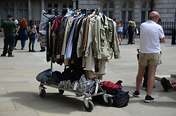 A costumes rail as the filming for the upcoming Bond film takes place on the Mall in London. The as-yet-untitled project has been shooting in Jamaica and at Pinewood Studios but the official 007 Twitter account confirmed the spy movie is now filming in the capital.
