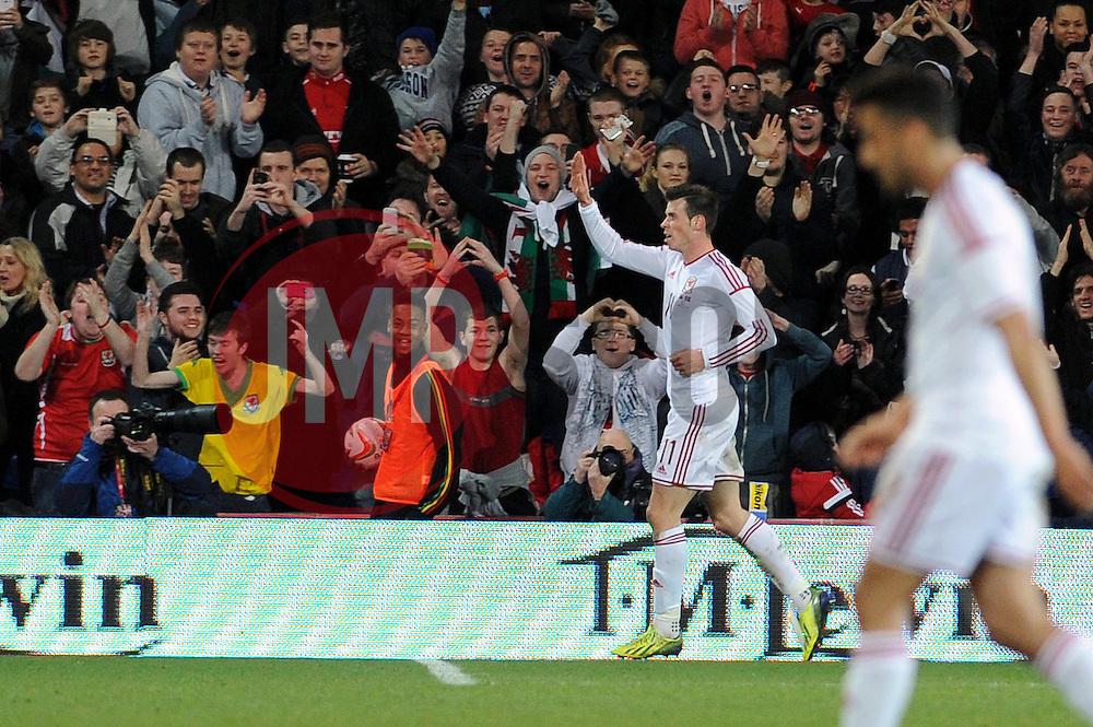 Gareth Bale of Wales (Real Madrid) celebrates his goal. - Photo mandatory by-line: Dougie Allward/JMP - Tel: Mobile: 07966 386802 03/03/2014 -