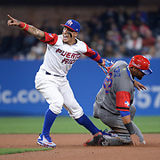 Mar 14, 2017; San Diego, CA, USA; Dominican Republic outfielder Nelson Cruz (23) is forced out at second base by Puerto Rico infielder Javier Baez (9) during the 2017 World Baseball Classic at Petco Park. Puerto Rico won 3-1. Mandatory Credit: Orlando Ramirez-USA TODAY Sports