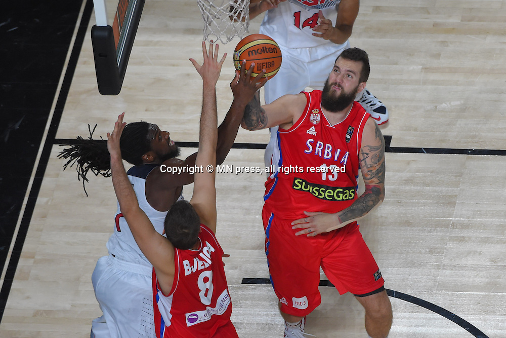 KENNETH FARIED of United states of America and MIROSLAV RADULJICA of Serbia basketball team in action during Final FIBA World cup match against MIROSLAV RADULJICA of Serbia, Madrid, Spain Photo: MN PRESS PHOTO<br /> Basketball, Serbia, United states of America, Final, FIBA World cup Spain 2014