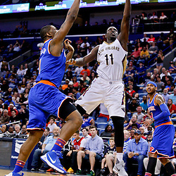Mar 28, 2016; New Orleans, LA, USA; New Orleans Pelicans guard Jrue Holiday (11) shoots over New York Knicks center Kevin Seraphin (1) during the second half of a game at the Smoothie King Center. The Pelicans defeated the Knicks 99-91. Mandatory Credit: Derick E. Hingle-USA TODAY Sports
