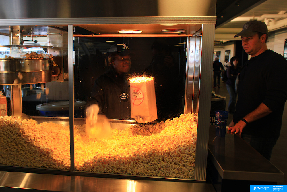 Popcorn is prepared for fans at Yankee Stadium during the New York Yankees V Detroit Tigers Baseball game at Yankee Stadium, The Bronx, New York. 28th April 2012. Photo Tim Clayton