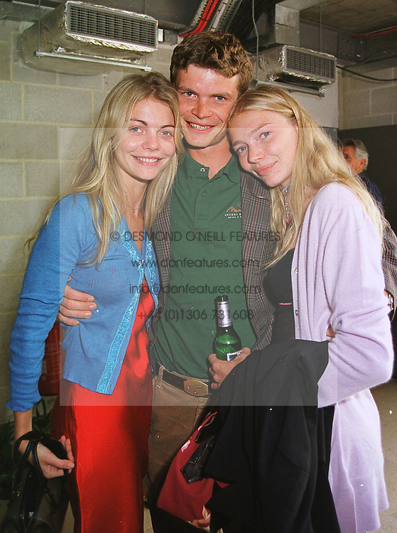 Left to right, MISS JEMMA KIDD, MR JACK KIDD and MISS JODIE KIDD the model, at a reception in London on 24th June 1999.MTS 54