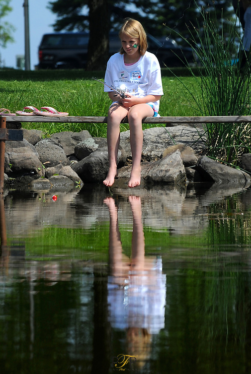 Jennifer Pflum, 10, of Rosendale, fishes off a pier during the annual Fish for Kids event held on Oven Island at Lakeside Park. Saturday, May 30, 2009. The Reporter photo by Patrick Flood.