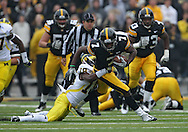 November 05, 2011: Iowa Hawkeyes wide receiver Marvin McNutt (7) tries to pull away from Michigan Wolverines defensive back Blake Countess (18) after a catch during the first quarter of the NCAA football game between the Michigan Wolverines and the Iowa Hawkeyes at Kinnick Stadium in Iowa City, Iowa on Saturday, November 5, 2011. Iowa defeated Michigan 24-16.