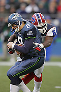 SEATTLE - NOVEMBER 28:  Quarterback Matt Hasselbeck #8 of the Seattle Seahawks gets sacked by linebacker Takeo Spikes #51 of the Buffalo Bills at Qwest Field on November 28, 2004 in Seattle, Washington. The Bills defeated the Seahawks 38-9. ©Paul Anthony Spinelli *** Local Caption *** Matt Hasselbeck;Takeo Spikes