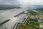 Nederland, Zeeland, Schouwen-Duiveland, 23-10-2013; Bruinisse, Enkele binnenvaartschepen in de vluchthaven, aan de kant van het Zijpe. <br /> Several barges in the port of Bruinisse near the Oosterschelde, South West Netherlands<br /> luchtfoto (toeslag op standaard tarieven);<br /> aerial photo (additional fee required);<br /> copyright foto/photo Siebe Swart.