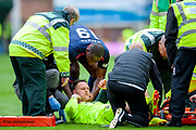 Uche Ikpeazu (#19) of Heart of Midlothian consoles injured Trevor Carson (#1) of Motherwell FC before the goalkeeper is stretchered from the field during the Ladbrokes Scottish Premiership match between Motherwell and Heart of Midlothian at Fir Park, Motherwell, Scotland on 15 September 2018.