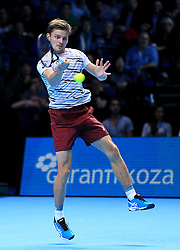 David Goffin in action against Novak Djokovic during day five of the Barclays ATP World Tour Finals at The O2, London.