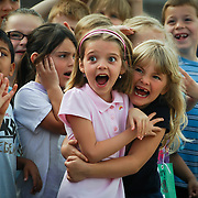 First graders, Madison Reedy, left, and Shiayn Cooper are thrilled to see an A-Star helicopter land at Cedar Pointe Elementary School, in Bristow,VA to conclude the school's Space Week, on  May 15, 2009.  For The News & Messenger