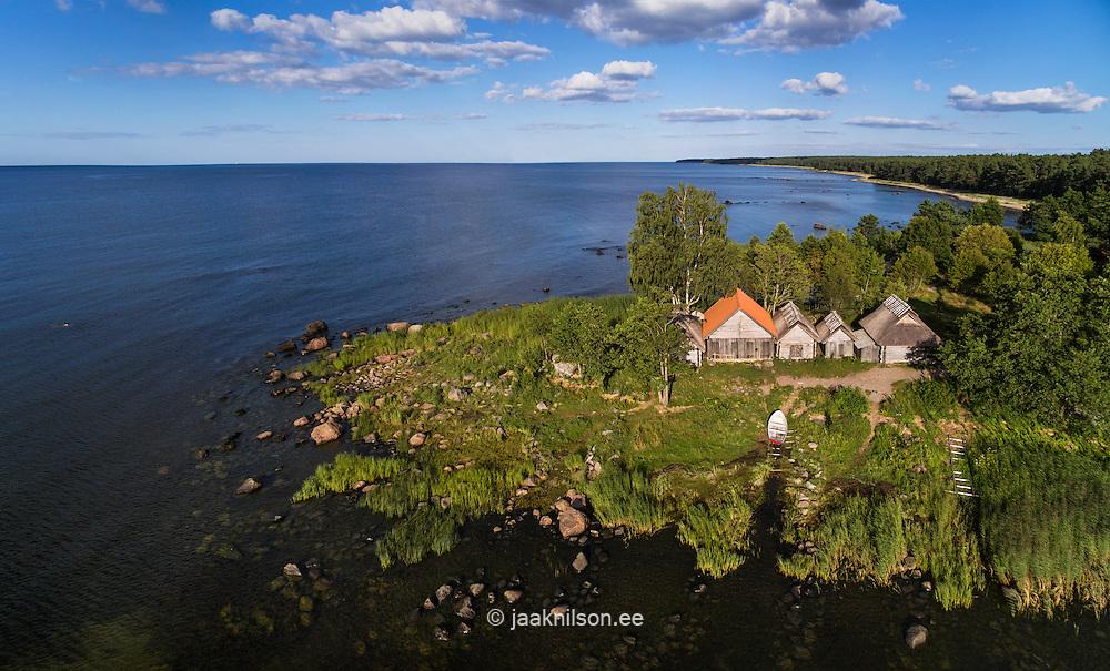 Altja fishing village in Lahemaa, Estonia. Fishermen boathouses. Aerial, Baltic sea, coastline. Wooden sheds, buildings side by side.