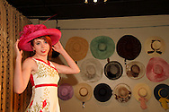 Model Stephanie Rene Osman wears a 1950s inspired dress during the Derby Fashion Extravaganza at Brim, in Dayton's Historic Oregon District, Friday, March 1, 2013.  Dresses for the show were all made by Tracy McElfresh of Sew Dayton.