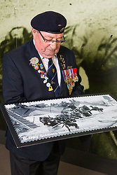 D-Day veterans Leading Stoker, Royal Navy, Fred Lee, 93, examines an enlarged Royal Mail D-Day commemorative stamp at the National Army Museum in Chelsea, London. The stamps will be released on 2nd June.. London, May 22 2019.