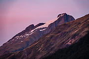 Sunset above Siberia Hut. The Gillespie Pass Circuit follows the Young and Wilkin Rivers in Mount Aspiring National Park, in the Southern Alps. Makarora, Otago region, South Island of New Zealand. UNESCO lists Mount Aspiring as part of Wahipounamu - South West New Zealand World Heritage Area.