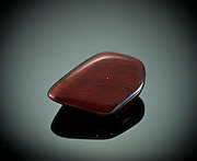 Cutout of a brecciated  jasper gemstone on black background