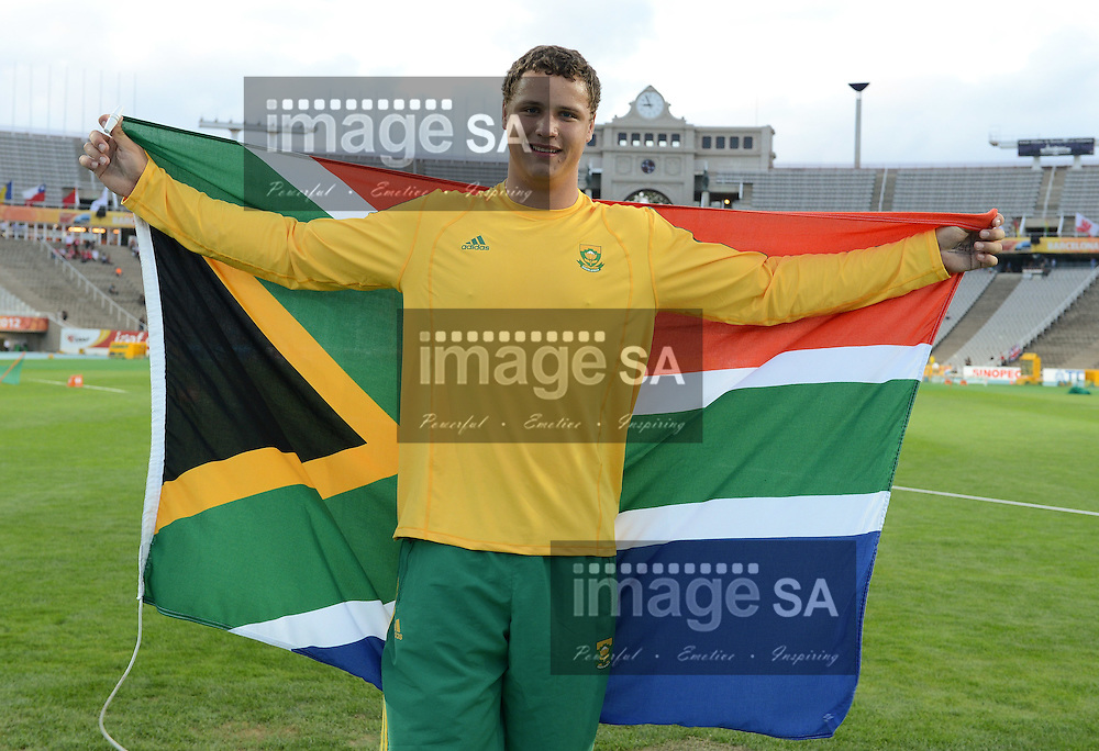 BARCELONA, Spain: Thursday 12 July 2012, Gerhard De Beer with the South African flag after he won the bronze medal in the mens discus during the afternoon session of day 3 of the IAAF World Junior Championships at the Estadi Olimpic de Montjuic..Photo by Roger Sedres/ImageSA