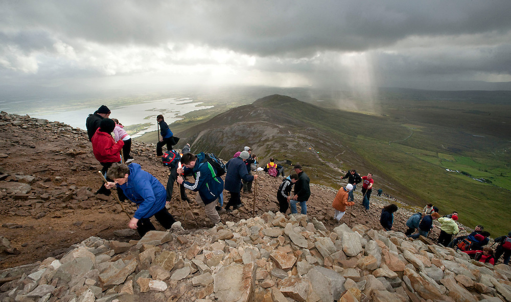 Early morning pilgrims  makes their way up and down Croagh Patrick, Co. Mayo. Pic: Michael Mc Laughlin Thousands of pilgrims navigate up and down the rugged slopes of croagh Patrick in honour of our Patron Saint, Saint Patrick, Ireland's Holy Mountain, Co. Mayo. Pic: Michael Mc Laughlin