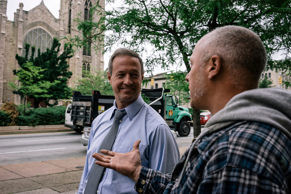 Former Maryland Governor Martin O'Malley talks with Baltimore resident Sergio Martinez, who is building a new art gallery in the area on Thursday, May 21, 2015. O'Malley is considering a run for President of the United States.
