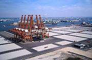 Nederland, Amsterdam, Westhaven, 17/05/2002; CERES Terminal aan Australiehavenweg;  ruim een jaar na de voltooiing staan de kranen er nog steeds werkeloos bij, er wordt nog steeds geen vracht aangeboden; het is de eerste containerterminal waar schepen gelijktijdig over beide zijden beladen en gelost kunnen worden; infrastructuur invenstering door de Havenbedrijf Gemeente Amsterdam; links (met zeilschepen) Noordzeekanaal, midden: Petroleumhaven met olietanks; aan de horizon elecyticiteitscentrale Hemweg; verkeer en vervoer economie . Scheepvaart.;<br /> luchtfoto (toeslag), aerial photo (additional fee)<br /> foto /photo Siebe Swart