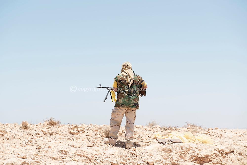Libya: A Libya's Government of National Accord's (GNA) fighter on the frontline with ISIS position in Sirte. Alessio Romenzi