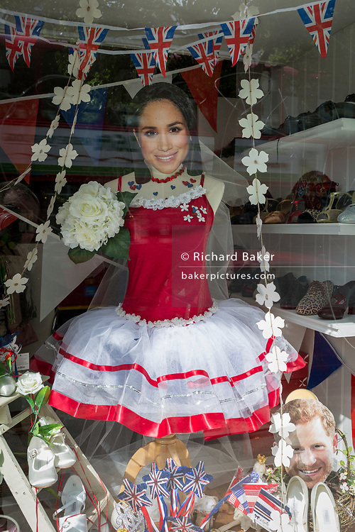 A week before the royal wedding between Prince Harry and Meghan Markle, the face mask of the American actress and future bride appears on a mannequin in a ballet accessories shop, on 13th May, in Herne Hill, London, England.