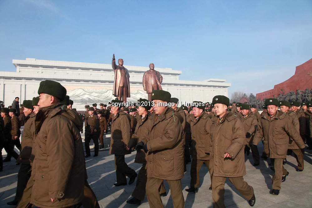60833524<br /> People pay tribute to the bronze statues of late top leaders Kim Il Sung and Kim Jong Il in Pyongyang, capital of the Democratic Peoples Republic of Korea (DPRK), Dec. 16, 2013. People gathered here on Monday to commemorate late leader Kim Jong Il for the second anniversary of his death which falls on Dec. 17. Monday, 16th December 2013. Picture by  imago / i-Images<br /> UK ONLY