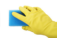 Hand in rubber gloves holding sponge
