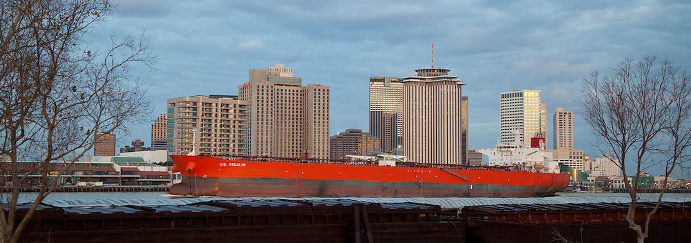 a ship, the C.S. Stealth, passes down the Mississippi River at downtown New Orleans