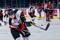 KELOWNA, CANADA - NOVEMBER 25: Tyler Preziuso #22 of the Medicine Hat Tigers warms up with a shot on net against the Kelowna Rockets on November 25, 2017 at Prospera Place in Kelowna, British Columbia, Canada.  (Photo by Marissa Baecker/Shoot the Breeze)  *** Local Caption ***