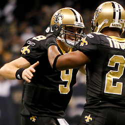 November 28, 2011; New Orleans, LA, USA; New Orleans Saints running back Pierre Thomas (23) celebrates with quarterback Drew Brees (9) following a touchdown during the fourth quarter of a game against the New York Giants at the Mercedes-Benz Superdome. The Saints defeated the Giants 49-24. Mandatory Credit: Derick E. Hingle-US PRESSWIRE