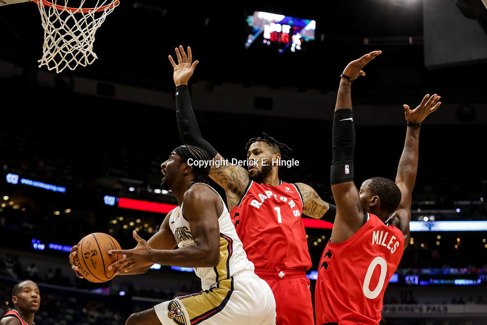 Oct 11, 2018; New Orleans, LA, USA; New Orleans Pelicans forward Solomon Hill (44) shoots over Toronto Raptors center Eric Moreland (1) and forward CJ Miles (0) during the first half at the Smoothie King Center. Mandatory Credit: Derick E. Hingle-USA TODAY Sports