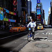 Citi Bike users in Times Square, Manhattan, New York. Citi Bike the NYC Bicycle Share Program sponsored by Citi Bank, launched in late May 2013 giving access to thousands of bikes at docking stations throughout  Manhattan and parts of Brooklyn. Manhattan, New York, USA. 4th June 2013. Photo Tim Clayton