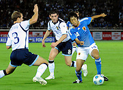 Japan's Kengo Nakamura (r) dribbles past Graham Dorrans and Steven Whittaker (l) during their friendly international match in Yokohama, Japan on Saturday 10 Oct. 2009. Japan won 2-0..Photographer: Robert Gilhooly