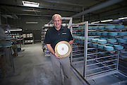 Andrew Pickard Morgan, CEO of Pickard China holds an official White House charger plate in Antioch Thursday morning. Pickard China recently made a full set of china for the White House which was used during the recent state dinner with Japanese leaders. The 320 person set included 12 total pieces each. The cost was $362,000.<br /> Michael R. Schmidt/For the Chicago Tribune