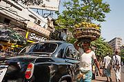 Man carrying goods in Kolkata streets (India).