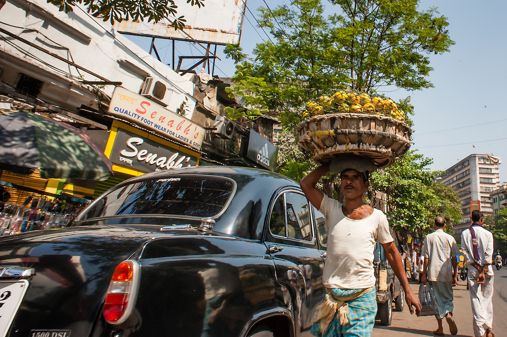 Man carrying goods in Kolkata streets (India).