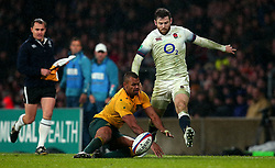 Elliot Daly of England kicks the ball away from Kurtley Beale of Australia on his way to scoring a try - Mandatory by-line: Robbie Stephenson/JMP - 18/11/2017 - RUGBY - Twickenham Stadium - London, England - England v Australia - Old Mutual Wealth Series