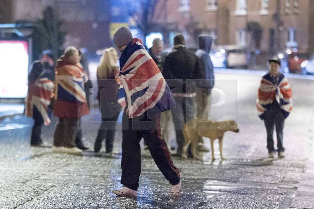 """© Licensed to London News Pictures . 11/01/2013 . Belfast , UK . Loyalist protesters in Castlereagh , East Belfast , block major routes in and out of Belfast as part of """" Operation Standstill """" today (11th January 2013) . The protest is one of many that have been held since Belfast City Council voted to stop flying the Union flag above Belfast City Hall . Photo credit : Joel Goodman/LNP."""