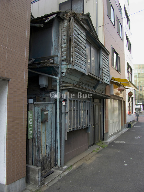 very old traditional wooden house in downtown Tokyo